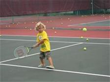 Photo of boy playing tennis at Hagen Park