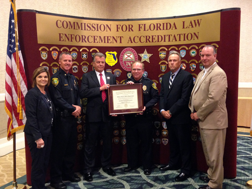 Chief accepts accreditation certificate