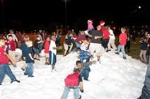 Photo of kids playing in the fake snow (real ice) at Santa's Enchanted Evening