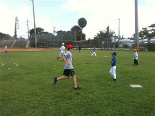Photo of kids playing baseball