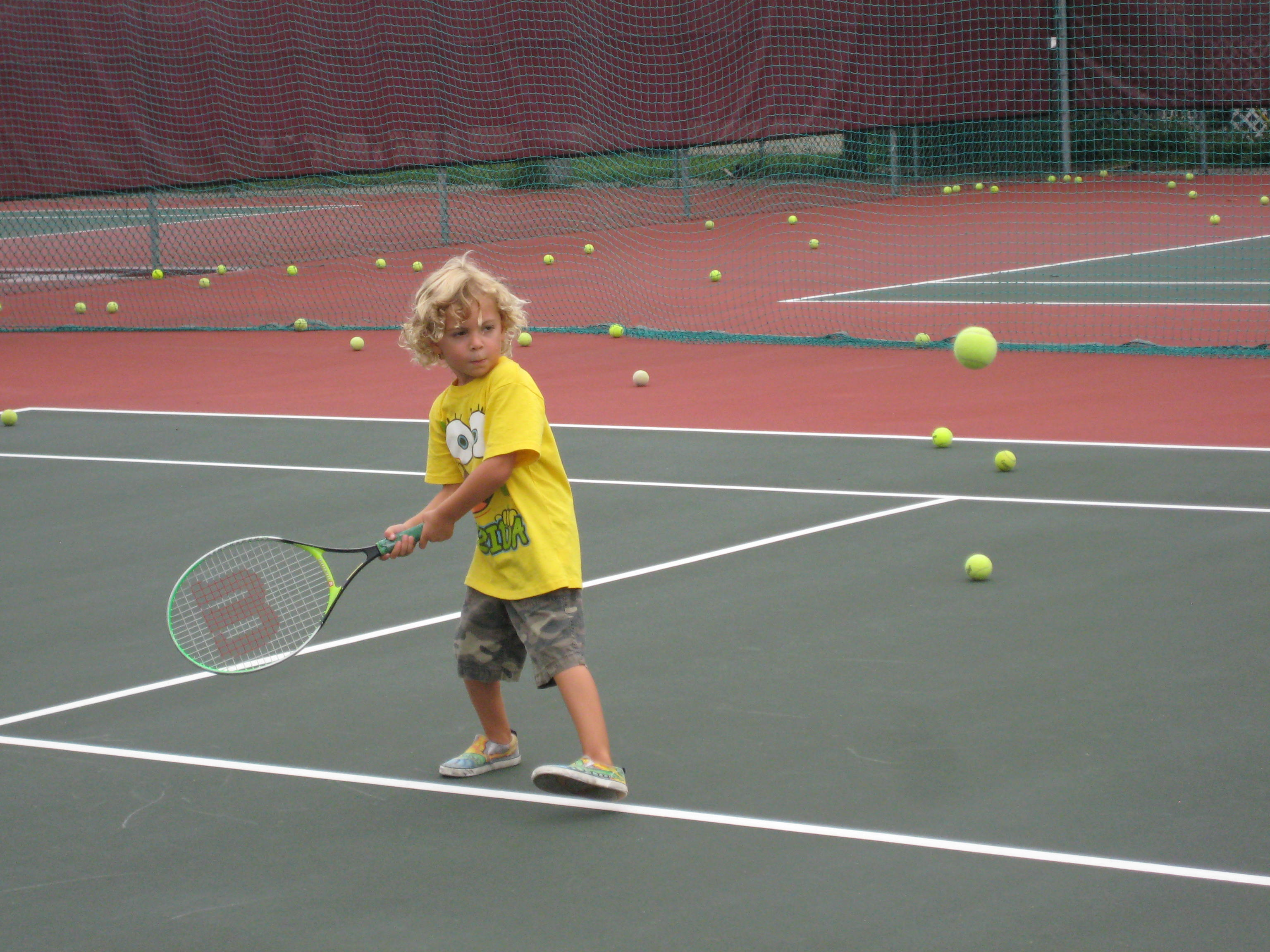 Photo of boy playing tennis