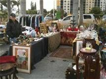 Photo of  yard sale vendor and his merchandise