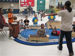 Photo of campers playing instruments in music class