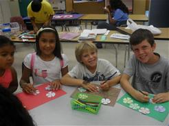 Photo of campers enjoying art class